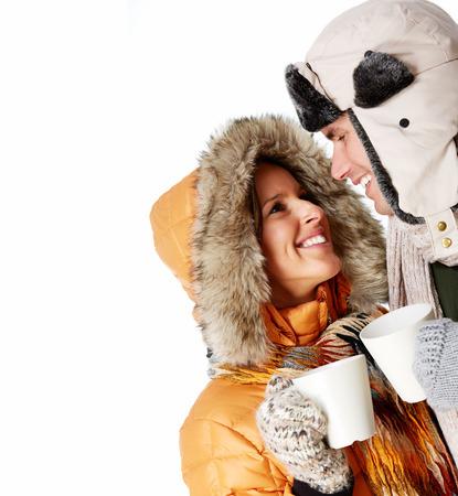 white winter: Christmas couple drinking hot tea isolated over white background  Stock Photo