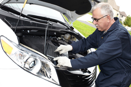 Car mechanic checking engine  Auto repair service  photo