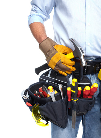Worker with a tool belt  Isolated over white background  photo