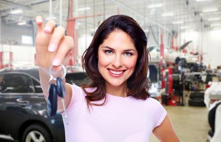 car loan: Beautiful young woman with a car keys