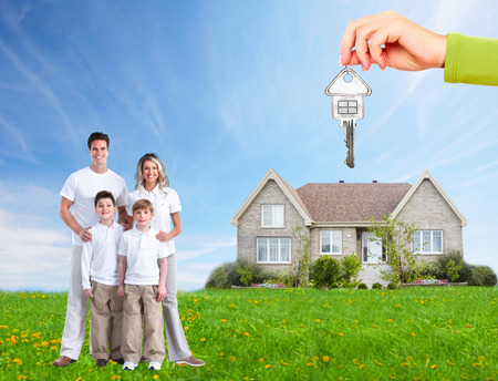 Happy family near new home. Mortgage concept. Stock Photo