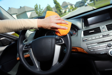 Hand with microfiber cloth cleaning car  photo