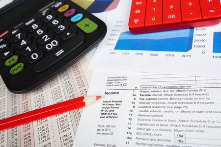 the bookkeeper: Calculator and office objects  Accounting and financial service  Stock Photo