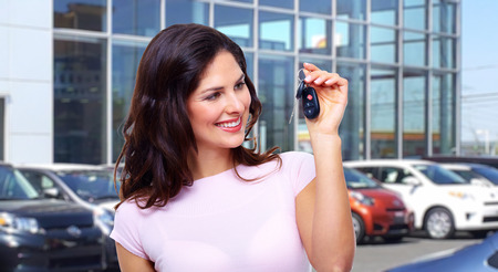 sell car: Beautiful young woman with a car keys