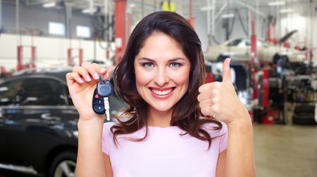 Beautiful young woman with a car keys  Stock Photo - 27922434