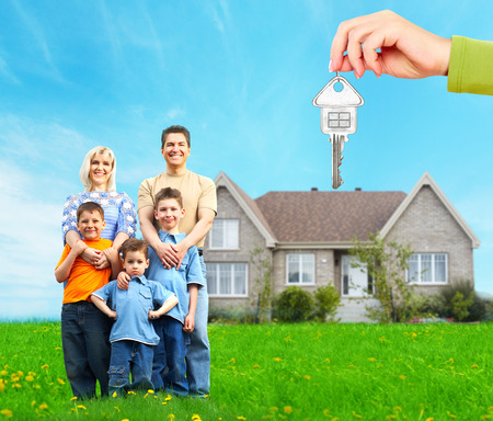 Happy family near new home  Mortgage concept  photo