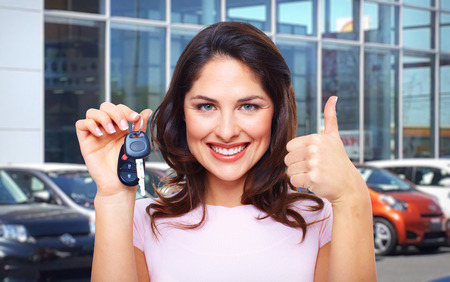 Beautiful young woman with a car keys. photo