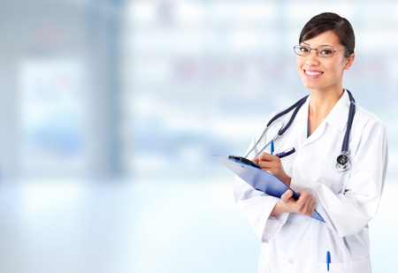 Beautiful smiling doctor woman over blue hospital  photo