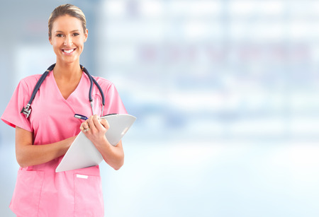 woman doctor: Beautiful smiling doctor woman over blue hospital