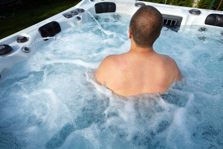 Man having massage in  hot tub Jacuzzi. Spa background. photo