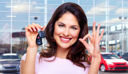 Beautiful young woman with a car keys. Stock Photo - 29697392
