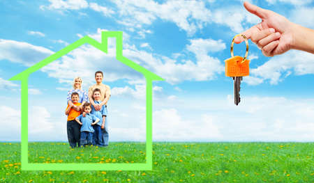 Happy family near new home. Mortgage concept. photo