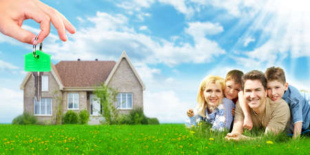 near: Happy family near new home. Mortgage concept. Stock Photo