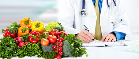 dietitian: Nutritionist doctor man Stock Photo
