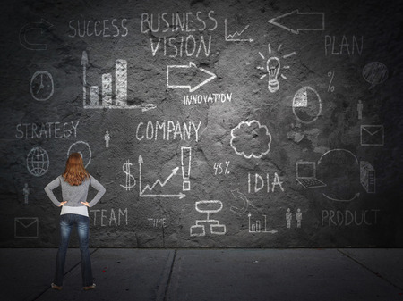 Young woman looking at innovation plan. photo