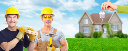 residential construction: Group of construction workers. House renovation.