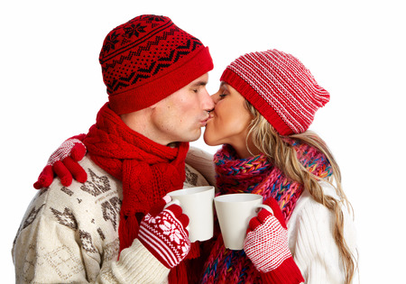new love: Christmas couple drinking hot tea.
