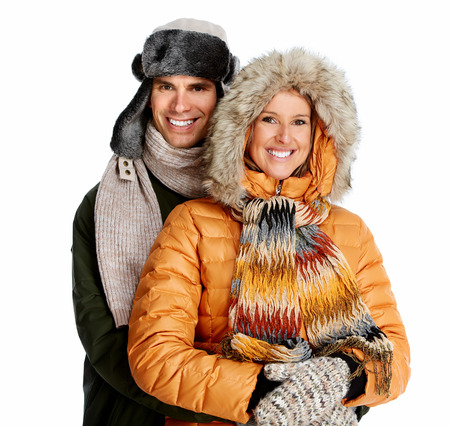 Happy christmas couple in winter clothing. photo