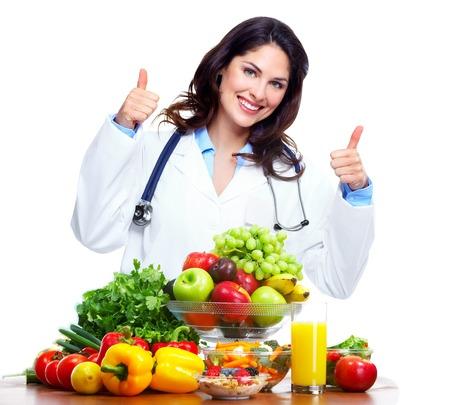 personas comiendo: Mujer m�dico nutricionista Foto de archivo