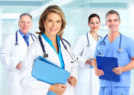 medical doctors: Medical doctors team over blue hospital background Stock Photo