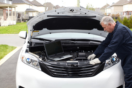 car maintenance: Car mechanic. Stock Photo