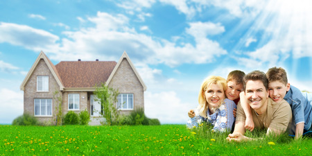 home building: Happy family near new home.