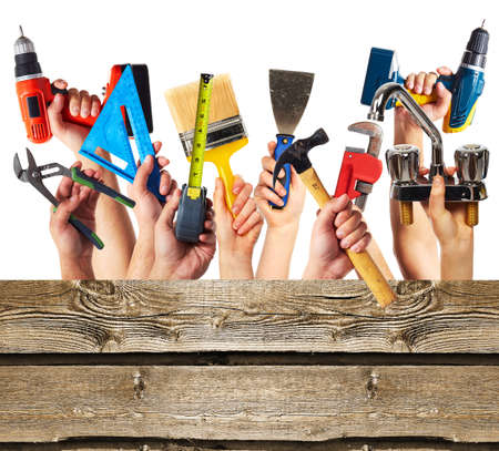 Hands with construction tools. photo