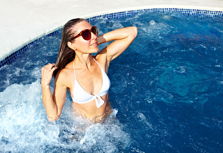 water hottub: Woman relaxing in jacuzzi