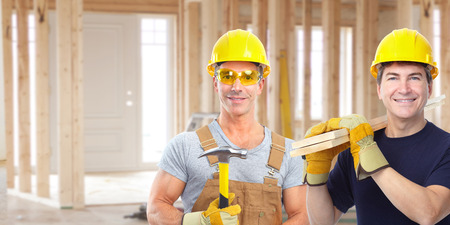 residential construction: Handyman with a hammer. House renovation. Stock Photo