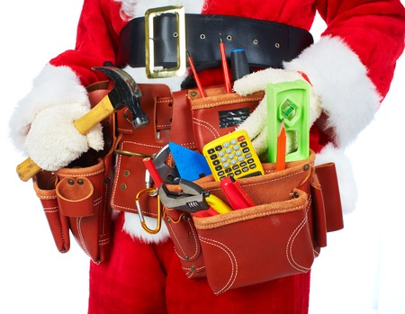 Santa Worker with a tool belt. photo