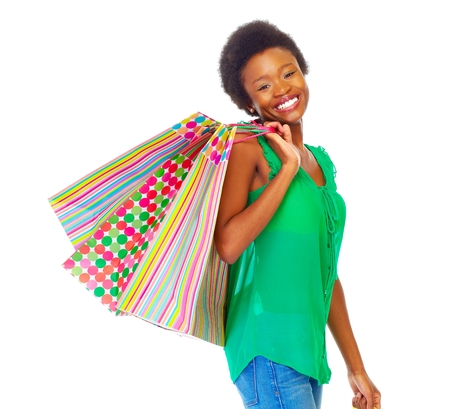 african american woman: Beautiful african girl with shopping bags. Stock Photo