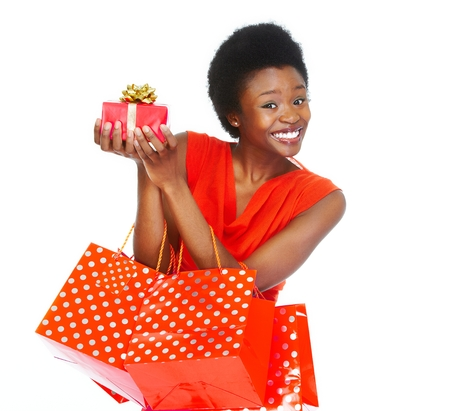 christmas shopping: African girl with shopping bags. Stock Photo