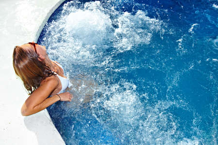Woman in jacuzzi photo