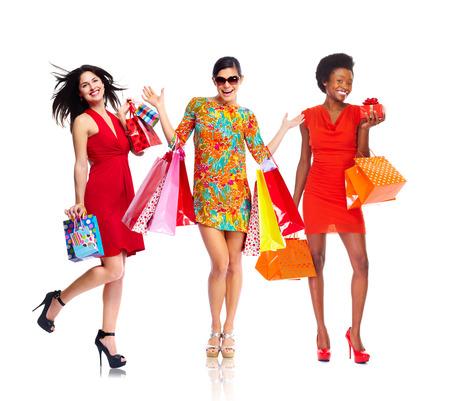 completo: Hermosas mujeres con bolsas de la compra. Foto de archivo