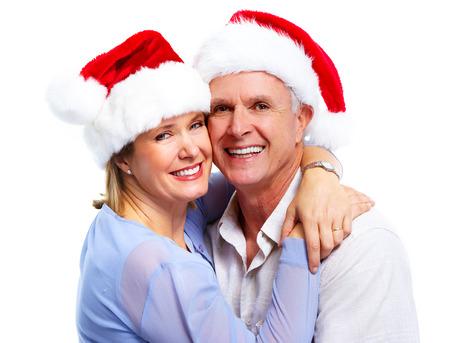 happy couple white background: Senior santa couple. Stock Photo