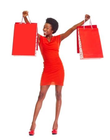 happy african woman: African girl with shopping bags. Stock Photo