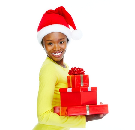 christmas shopping: Beautiful african girl with gifts. Stock Photo