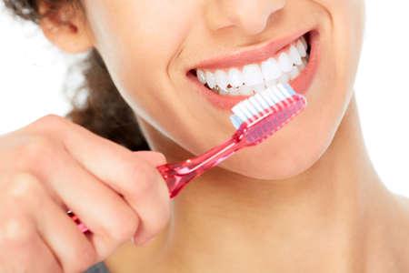 the brush: Mujer con el cepillo de dientes.