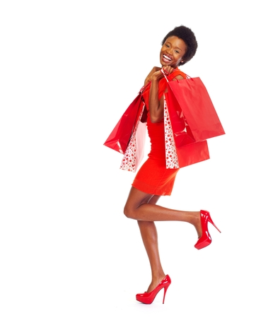 sales person: African girl with shopping bags. Stock Photo