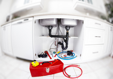 sink drain: Plumber tools on the kitchen.