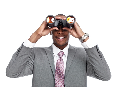 African-American businessman with binoculars. photo