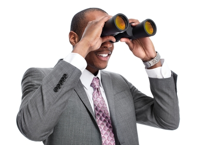 looking at watch: African-American businessman with binoculars. Stock Photo