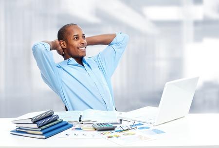 Relaxing black businessman. photo