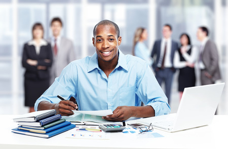 group  accountant: African-American black businessman in office.
