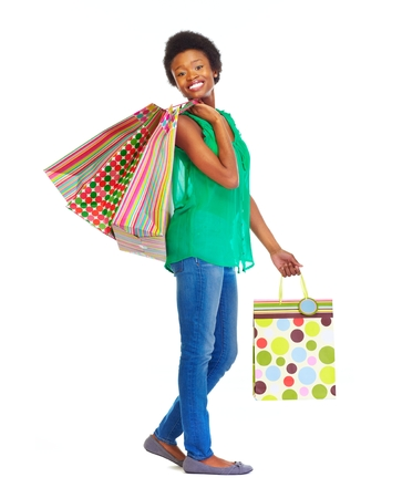 happy african woman: Beautiful african girl with shopping bags. Stock Photo