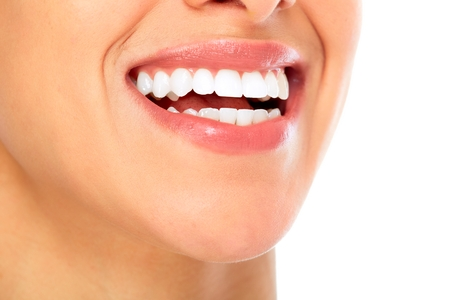 whitening: Beautiful young woman smile. Dental health background. Stock Photo