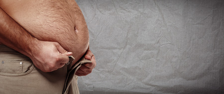 belly fat: Fat belly. Man with overweight abdomen. weight loss. Stock Photo