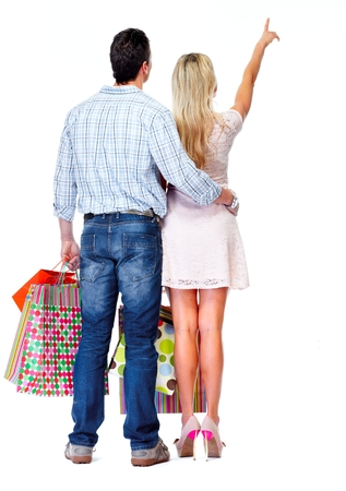 Loving couple with shopping bags isolated white background. photo