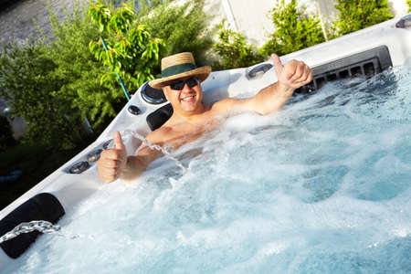hot tub: Man having massage in  hot tub spa.