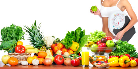 lose balance: Woman with scales and apple fruits and vegetables background